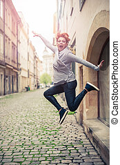 Young woman jumping on the street