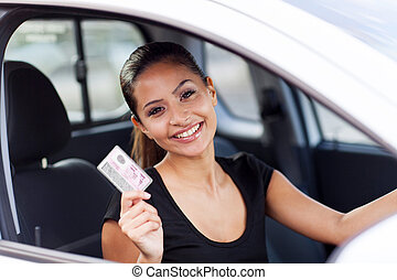 young woman just got her driving license - cheerful young...
