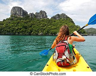 Young woman kayaking in Ang Thong National Marine Park,...