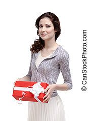 Young woman keeps a gift