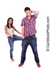 Young woman kicking her boyfriend