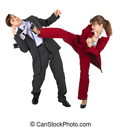 Young woman kicks man in business suit