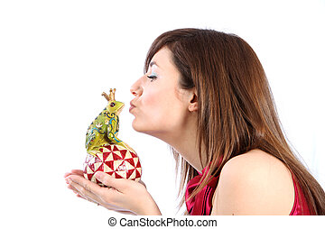 Young woman kissing a frog king