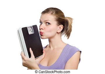 young woman kissing a weight scale