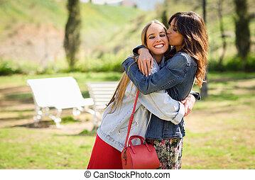 brunette-teen-giving-her-friend