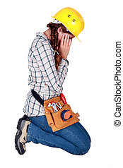 Young woman laborer holding her head