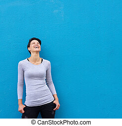 Young woman laughing and looking up