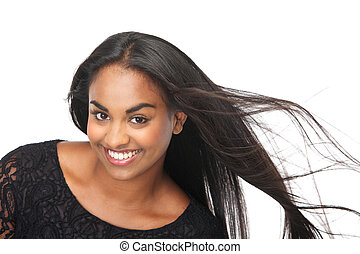 Young woman laughing with hair blowing