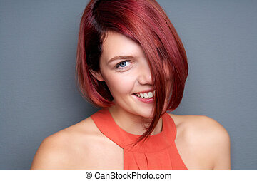 Young woman laughing with red hair