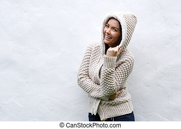 Young woman laughing with wool sweater