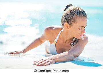 Young woman laying on beach