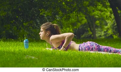 Young woman laying on the grass in the park
