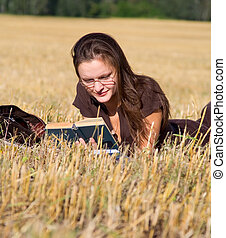 Young woman lays on yellow field