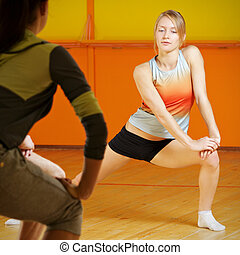 Young woman leading aerobics group
