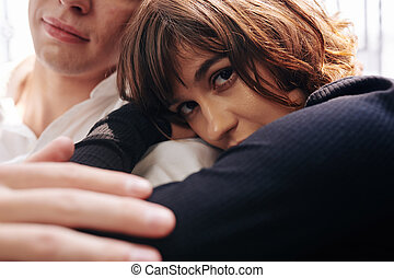 Young woman leaning on boyfriends shoulder