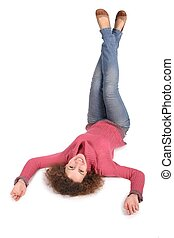 young woman lies by feet upward on the the white