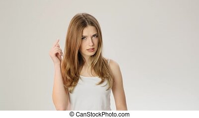 Young woman listening gossip and can't hear it slow motion -...