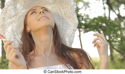 Young woman listening music, lickin