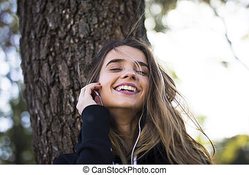 Young woman listening music outdoor