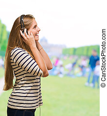 Young Woman Listening On Headphones
