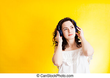 Young woman listening the music