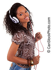Young woman listening to music - Young beautiful black woman...