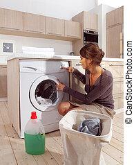 woman loading the washing machine