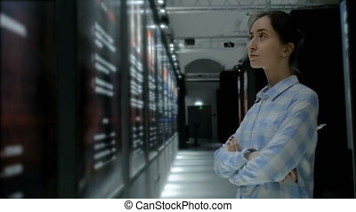 Young woman looking around in modern historical museum -...