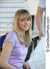 Young woman looking at a diagram in an office