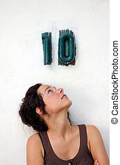 young woman looking at a ten