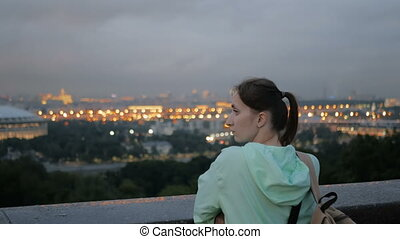 Young woman looking at cityscape of Moscow