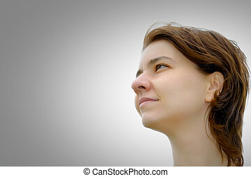Young woman looking at copyspace
