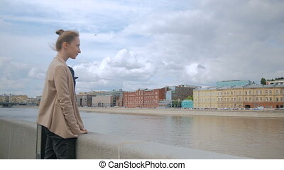 Young woman looking at historical part of city