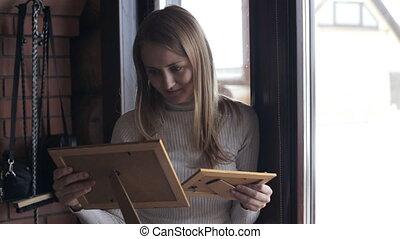 Young woman looking at photos