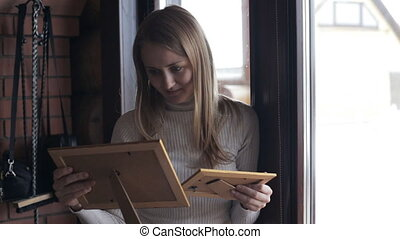 Young woman looking at photos