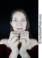 Young woman looking at ring