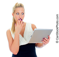 Young woman looking at tablet computer with surprise. Isolated on white