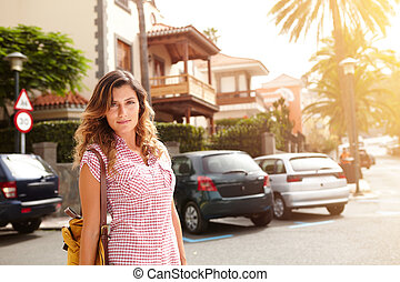 Young woman looking at the camera outdoors