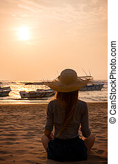 Young woman looking at the sunset