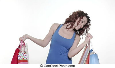 Young woman looking into gift bags