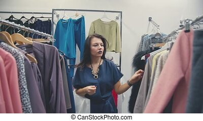 Young Woman Looking New Clothes During Shopping.