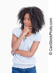 Young woman looking on the side while crossing her arms with...