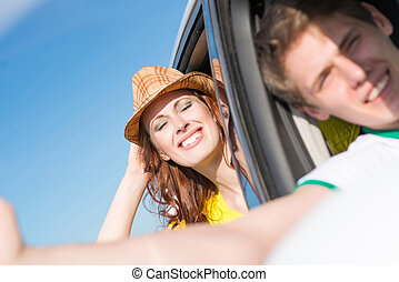Young woman looking out of car window
