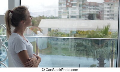 Young woman looking out the window