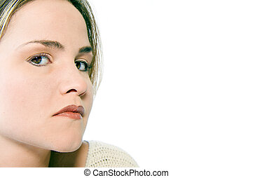 Young caucasian woman in the studio looking sideways