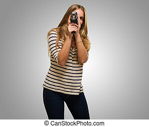 Young Woman Looking Through A Camera