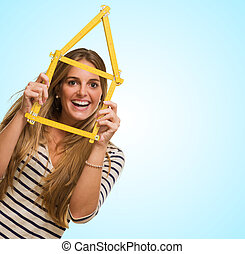 Young Woman Looking Through House Frame
