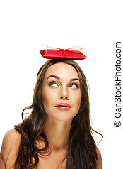 young woman looking to the present on her head on white background
