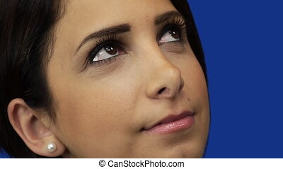 Young woman looking up at sky - Blue Screen Background -...