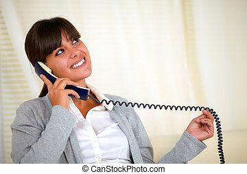 Young woman looking up speaking on phone
